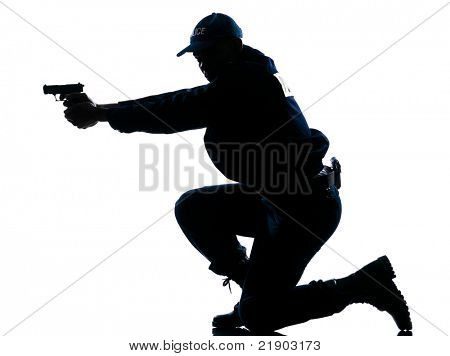 Side view of a silhouetted Afro American police officer aiming gun isolated on white background