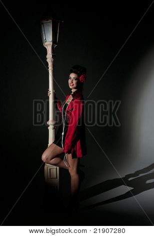 beautiful young glamorous woman  with light pole