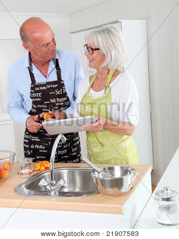 Senior couple preparing apricot jam