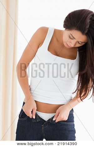 Pretty Woman Trying To Close Her Jeans