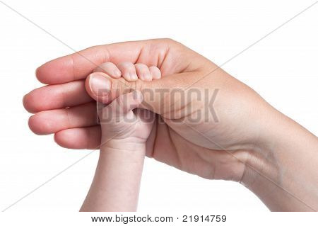 baby's hand holding thumb of mother