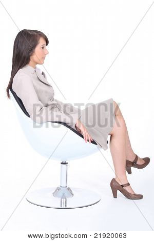 Young trainee sitting in armchair