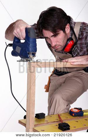 carpenter using sander machine