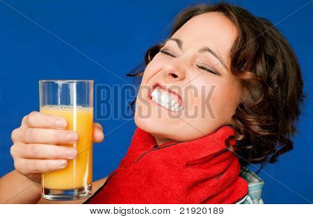 woman in pain, holding glass of orange juice, being strangled by the throat