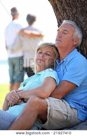 Mature couple dozing in the sunshine