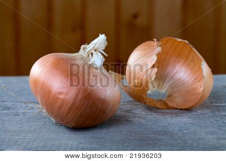 Onions And Peel On A Table From  Boards