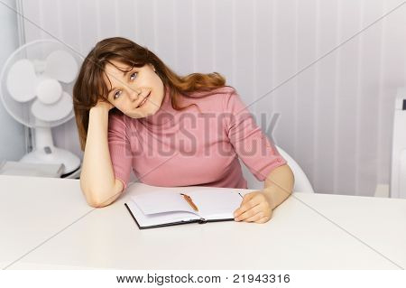 Beautiful Woman Sitting At Table