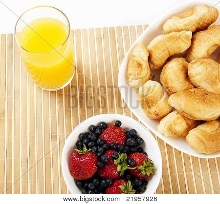 Breakfast Juice, Croissants And Berries On A Table