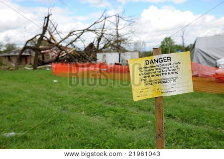 SAINT LOUIS, MO - APRIL 22:Sign in front of destruction left behind by tornadoes that ravaged the area. April 22, 2011 in Saint Louis, Missouri