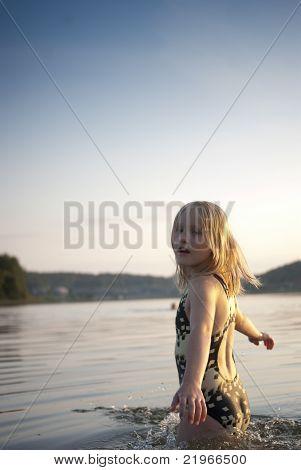 Girl Smilimg In Lake