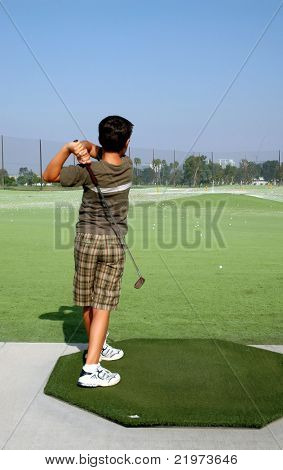 Young boy at Golf Range