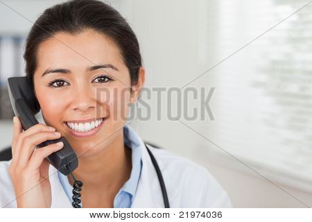 Lovely Female Doctor On The Phone And Posing