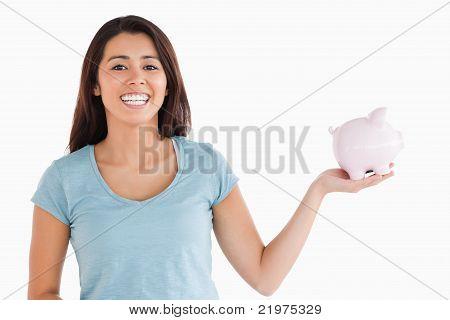Beautiful Female Holding A Piggy Bank