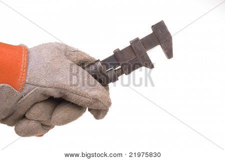 Gloved hand with old wrench isolated over white