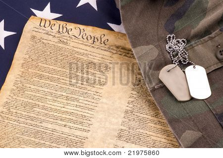 Military Dogtags on American Flag and Constitution and Military Uniform