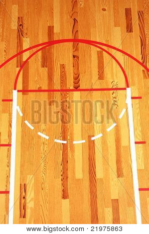 Basketball Key painted on hardwood floor in gymnasium