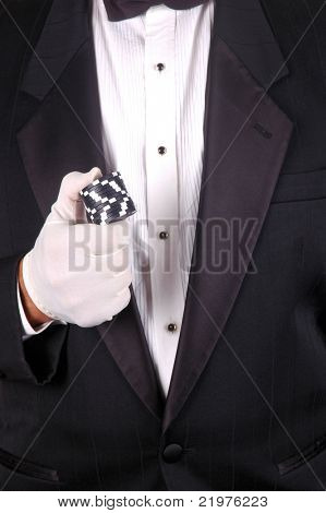 Man in Tuxedo Holding a Stack of Poker Chips in Gloved Hand