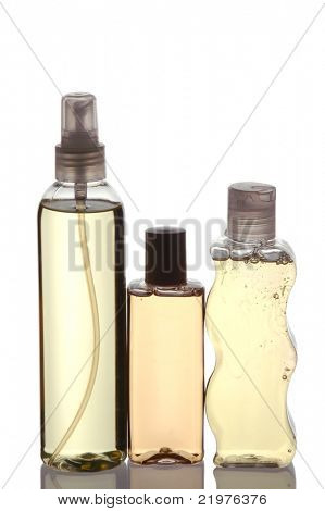 Three Plastic Shampoo Bottles with reflection isolated on white