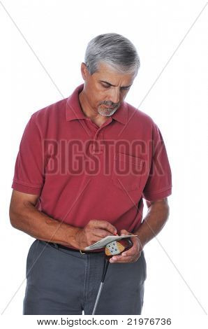 Middle Aged Golfer leaning on driver and writing on scorecard