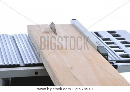 Table Saw Blade Cutting Through Board isolated over white