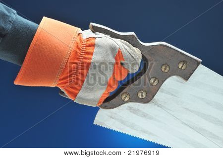 Construction Worker hand and arm with saw over blue gradient background
