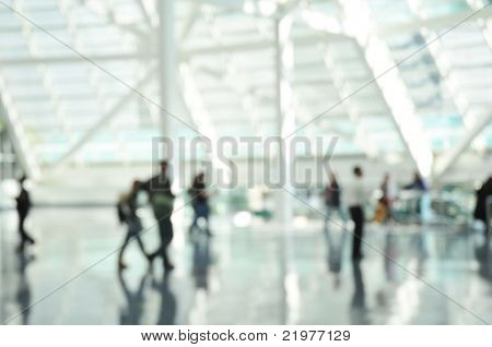 Blurred image of travellers in Airport or Railway Station for use as background