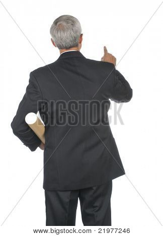 Middle Aged Businessman in Suit With Cardboard Shipping Tube Pointing viewed from behind isolated on white