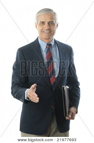 Middle Aged Businessman in Blue Blazer and Khaki Trousers with hand extended to shake vertical format isolated