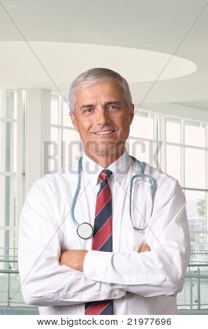 Portrait of a Middle Aged Male Doctor in Modern Medical Facility vertical