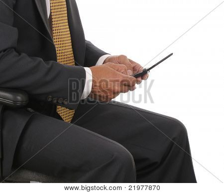 Close up of a seated businessman holding his cell phone in horizontal format over white background. Man is only showing from his shoulders to his lap.