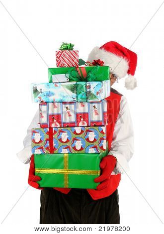Santa Claus' Helper carrying a stack of wrapped presents. Man is peeking around the side of a too large stack. Vertical Format isolated on white.