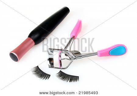 decorative eyelashes, mascara and curling eyelashes isolated on white