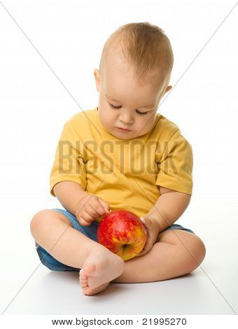 Cute Little Boy With Red Apple