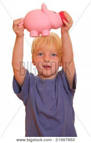 Boy Shows A Piggy Bank