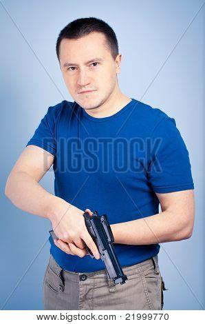 Confident man holding handgun