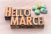 Hello March in vintage letterpress wood type with green gemstone crystals poster