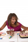 foto of bulimic  - Pretty black girl looking very greedy and happy with all sort of sweets in front of her - JPG