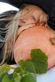 pic of jack-o-laterns-jack-o-latern  - Young blond girl dresses in hallowwen witch costume - JPG