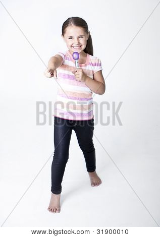 Cute little Pop Star singing on white background
