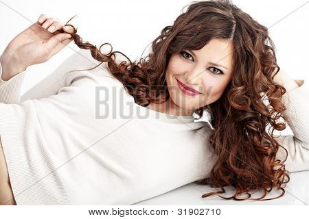 Portrait of young beautiful woman with long curly volume hair