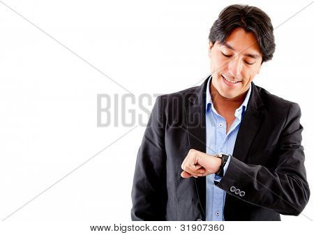 Businessman checking the time on his watch - isolated ove a hwite background