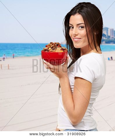Beautiful Healthy Woman Holding Bowl Of Cornflakes