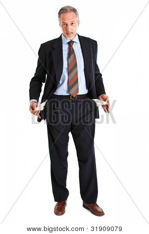 Elder businessman turning out empty pockets isolated on white