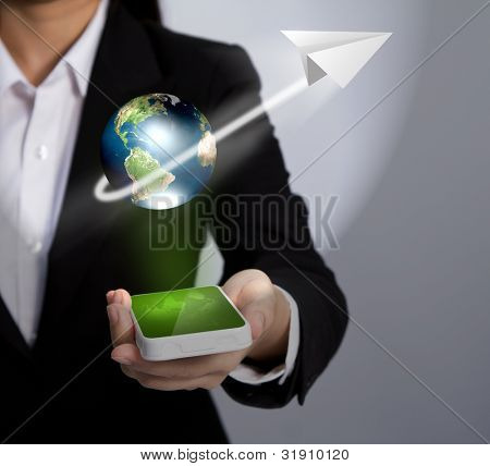 Hand holding a phone show Earth and paper plane  (Elements of this image furnished by NASA)