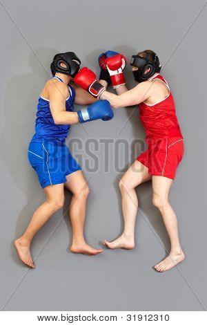 Vertical shot of two men in sportswear fighting