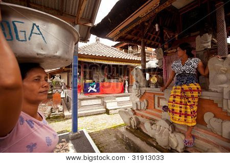 BALI, INDONESIA - MARCH 28: Unidentified people during the ceremonies of Oton- is the first ceremony for baby's on which the infant is allowed to touch the ground on March 28, 2012 on Bali, Indonesia.