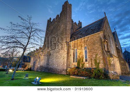 Holy Trinity Abbey church in Adare at night, Co. Limerick, Ireland