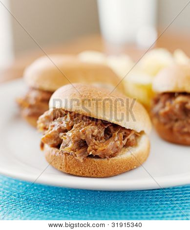 three pulled pork bbq mini sandwich sliders.