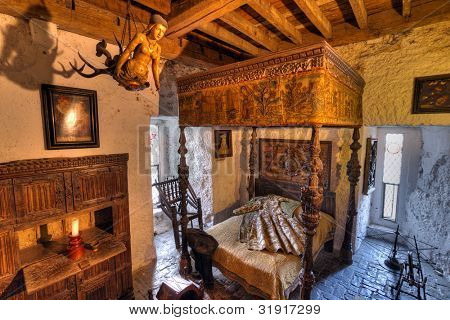 BUNRATTY, IRELAND - FEB 19: Ancient bedroom interior of 15th century Bunratty castle, traditional Irish tourist attraction of Co. Clare - Feb 19, 2012 in Bunratty Castle, Co. Clare, Ireland.