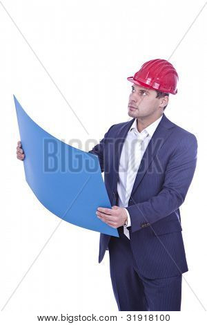 Architect in red hardhat holding blueprint over white background